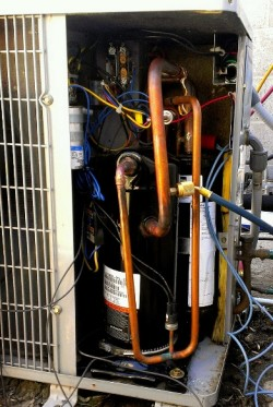 Open HVAC unit with compressor. |HVAC 101 | Air Conditioning Service